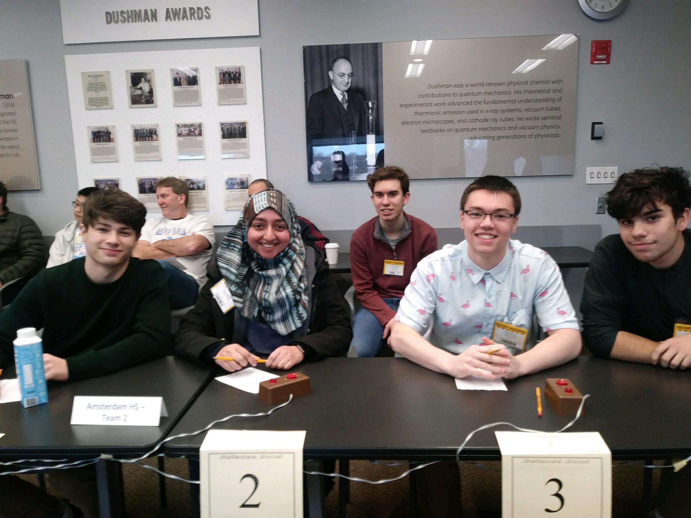 four high school students at a table