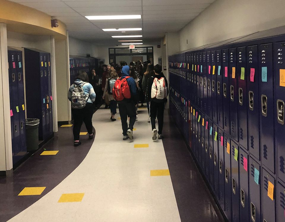 students walk the halls of the high school