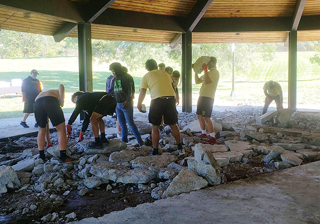 big students moving big rocks