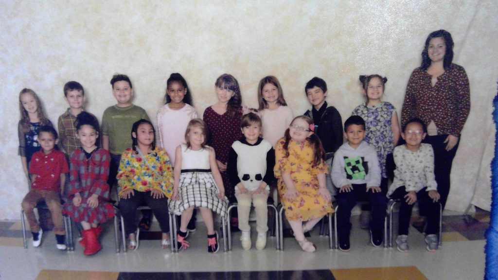 class photo of second grade students and their teacher