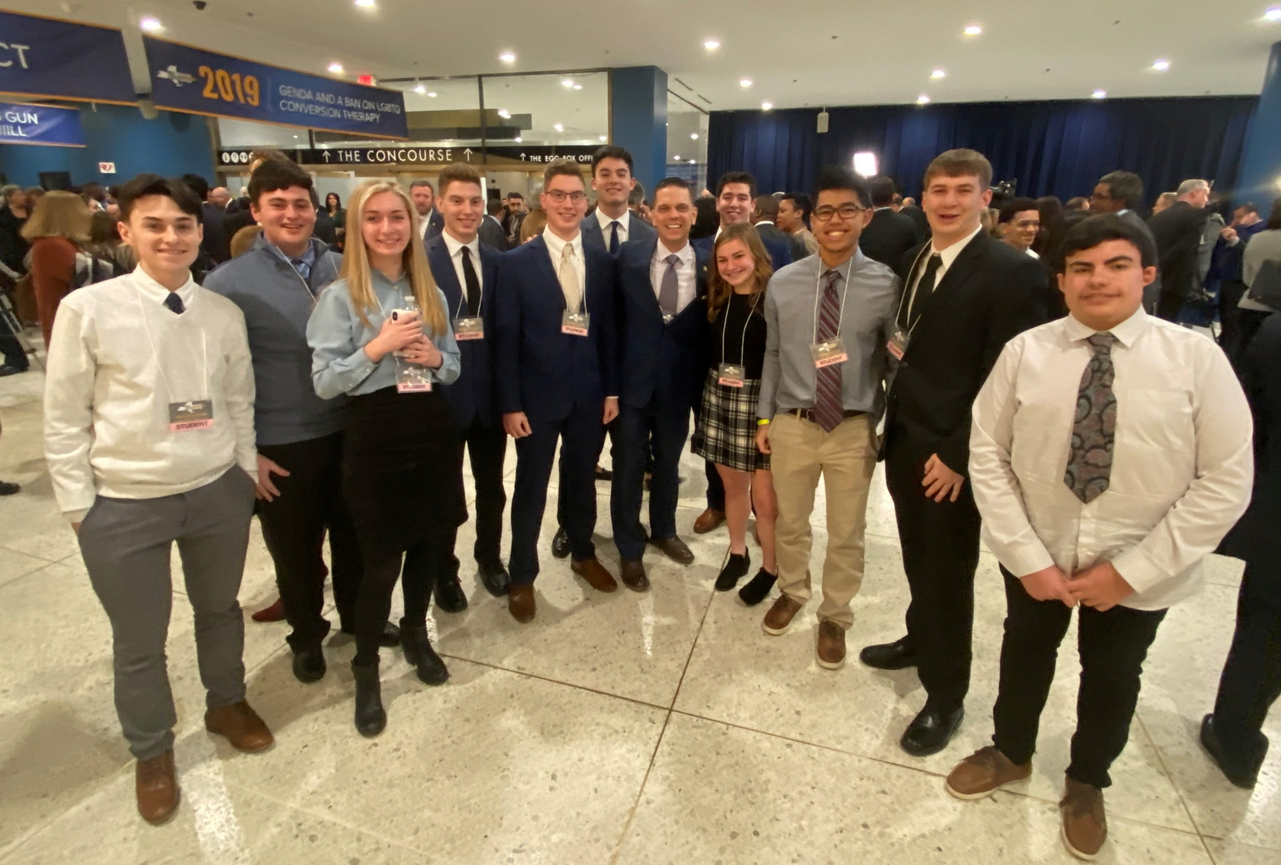 group of high school students pose with assemblyman