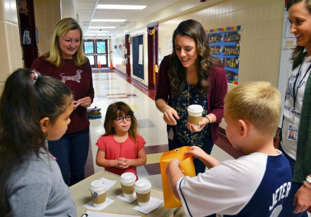 Students sell coffee to teachers as part of Coffee Cart program.