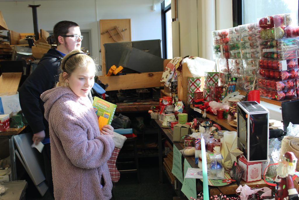Students browsing for gifts at the school's Holiday Shop.
