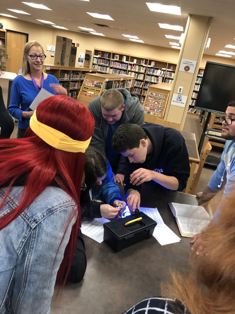 students work together to unlock box