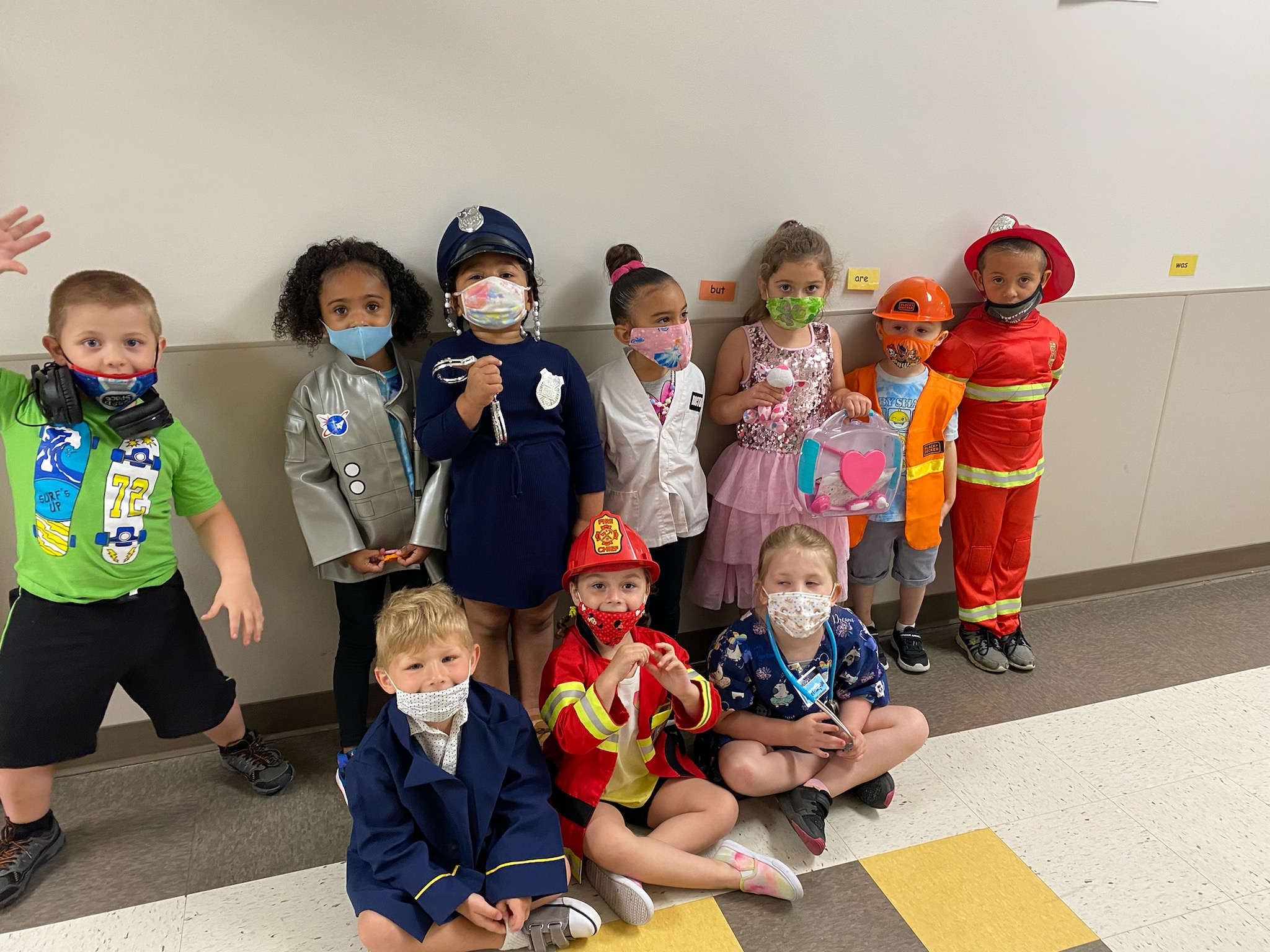 group of kids dressed in career clothing