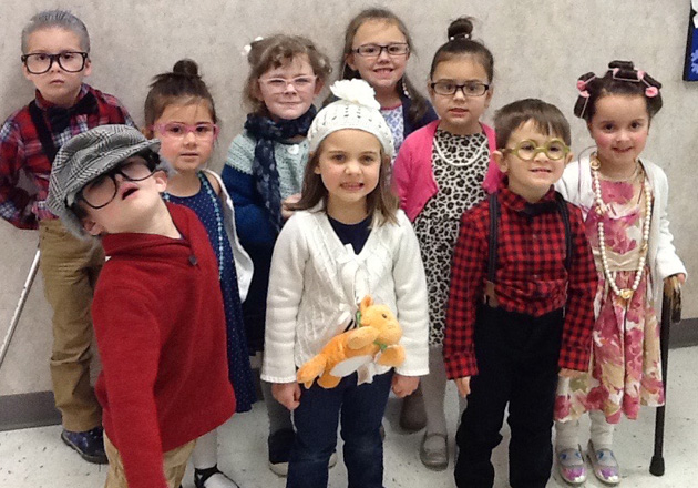 group of kindergartners dressed as old people