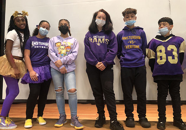 group of middle school students dress in school spirit attire