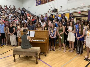 chorus students singing at a graduation ceremony