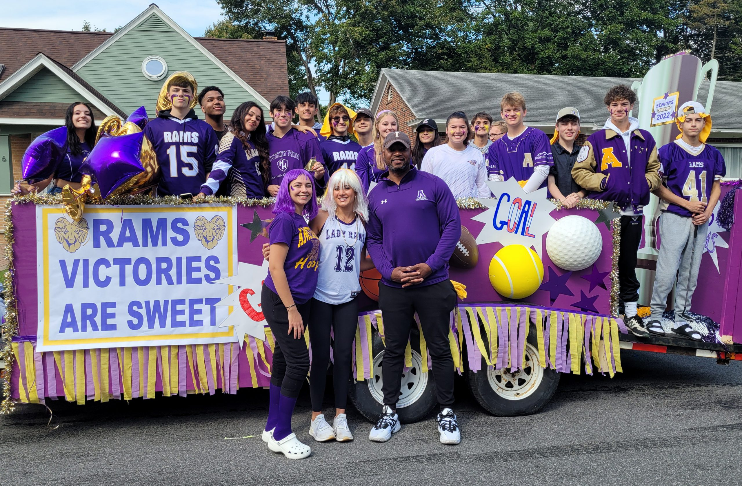 Group of students on a Homecoming float
