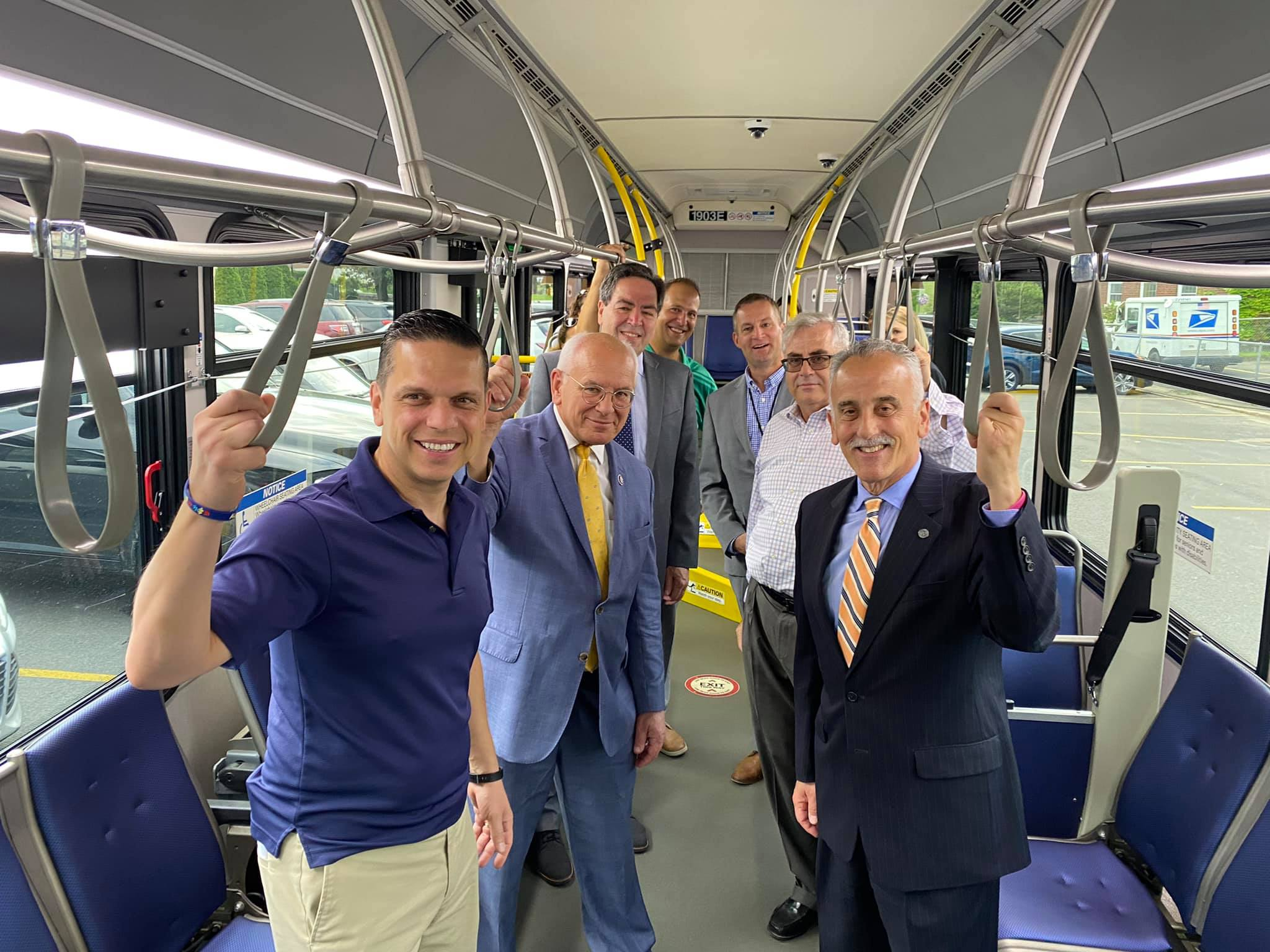 officials ride a city bus together